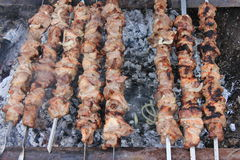 Meat on skewers grilled over charcoal Stock Photography