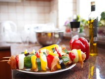 Meat skewers ready for grilling. Consisting of chicken meat, eggplant, zucchini, peppers and onions with kitchen background stock photo