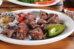 Meat skewers restaurant service Stock Photography