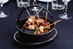 Meat on skewers smoks in a brazier Stock Photos