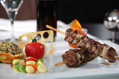 Meat Skewers with tomato and rice. On a white dish Stock Photography