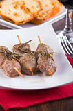 Meat skewers on white dish. Royalty Free Stock Images
