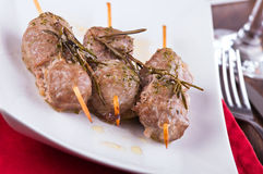 Meat skewers on white dish. Royalty Free Stock Photography