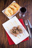 Meat skewers on white dish. Stock Photo