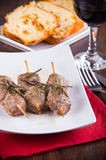 Meat skewers on white dish. Stock Photos