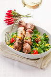 Meat Skewers on white table. Delicious broiled meat skewers on white table stock photo