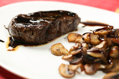 Meat slice with black sauce and mushrooms Royalty Free Stock Photography