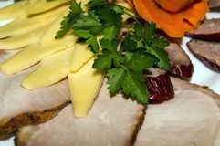 Restaurant business. Meat sliced on white plate with cheese and parsley stock image