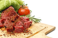 Meat sliced in cubes with vegetables Royalty Free Stock Image