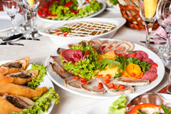 Meat slices. Various meat slices on white plate - collation Stock Image