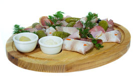 Meat slices with cucumber. on the wooden substrate. on isolated background. Meat slices with cucumber and green, on the wooden substrate. on isolated background Royalty Free Stock Image