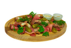 Meat slices with cucumber. on the wooden substrate. on isolated background. Meat slices with cucumber and green, on the wooden substrate. on isolated background Stock Photos