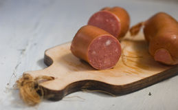 Meat with slices of fat sausages Royalty Free Stock Photo