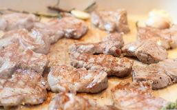 Meat slices roasted on giddle Stock Photo