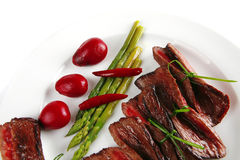 Meat slices on white dish Royalty Free Stock Image
