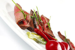 Meat slices on white dish Royalty Free Stock Photo
