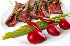Meat slices on white dish Stock Photo