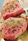Meat with smoked sausage, pepper and garlic on wooden board Royalty Free Stock Image