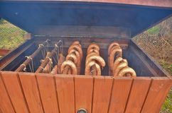 Meat smoking. This is a view of meat smoking in small home smoker Stock Image