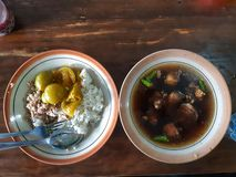 Meat soup of east java. Traditional food made from meat and & x22;kluwak& x22; from east java stock photography