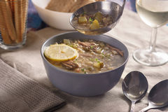 Meat soup with lemon, wine and bread Stock Photos