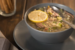 Meat soup with lemon, wine and bread Royalty Free Stock Image