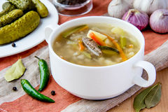Meat soup with pickled cucumbers and  pearl barley Royalty Free Stock Image