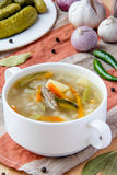 Meat soup with pickled cucumbers and  pearl barley Royalty Free Stock Photos
