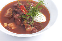 Meat soup with red pepper Stock Photos