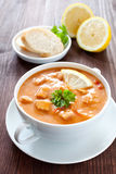 Meat soup solyanka. Fresh meat soup solyanka with baguette Stock Images