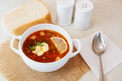 Meat Soup Solyanka, on a wooden table. Royalty Free Stock Image