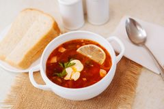 Meat Soup Solyanka, on a wooden table. Stock Image