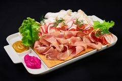 Meat and sowbelly set. pub, restaurant, bar food concept. meat appetizers set with meat, sowbelly, tomatoes cherry, souses and. Fresh greens stock images