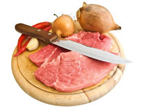 Meat and spices. Pieces of meat with kitchen knife and some spices Stock Images