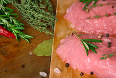 Meat and spicy herbs on the wooden background Stock Image
