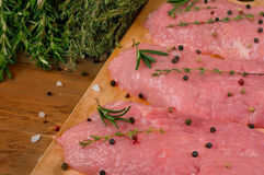 Meat and spicy herbs on the wooden background Royalty Free Stock Photo