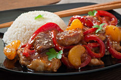 Meat in a spicy sauce, sweet pepper and tangerines Stock Image