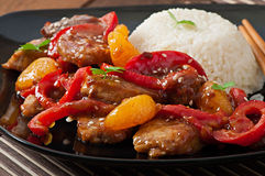 Meat in a spicy sauce, sweet pepper and tangerines Royalty Free Stock Photo