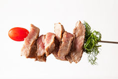 Meat on the spit on white. Background royalty free stock photography