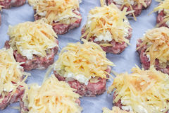 Meat stacks raw fresh pork cutlets with fried onions and boiled eggs and potatoes Stock Images