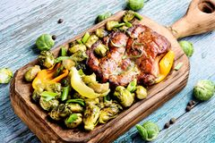 Meat steak with brussels sprouts royalty free stock photography