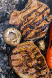 Meat steak on grill Stock Photos