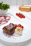 Meat steak grilled beef barbecue with garlic sauce and tomatoes Royalty Free Stock Image