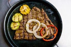 Meat steak on pan Stock Photo