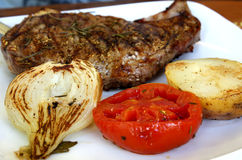 Meat steak on the plate with vegetables Royalty Free Stock Images