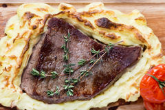 Meat steak with potato puree backed on wood board Royalty Free Stock Photos