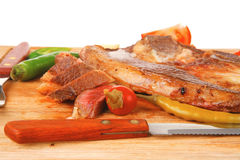 Meat steak and red hot pepper  on wood Stock Photos