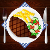 Meat steak salad french fry plate wooden table Stock Photography