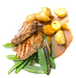 Meat steak served with potato and peas.Isolated. Royalty Free Stock Photography
