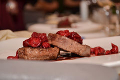Meat steak under cherry sauсe Stock Images